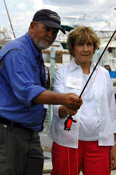 Captain Pete Greenan teaching a woman to flycast